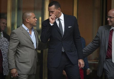 New York Yankees baseball player Alex Rodriguez (C) speaks to Fernando Mateo (L), president of Hispanics Across America, outside the Major L