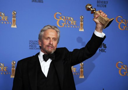 "Michael Douglas poses backstage with the award for Best Actor in a Mini-Series or TV Movie for his role in ""Behind the Candelabra"" at the 71"
