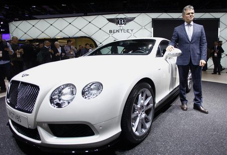 Dr. Wolfgang Schreiber, Chairman and CEO of Bentley, speaks next to the Bentley GT V8 S during the press preview day of the North American I