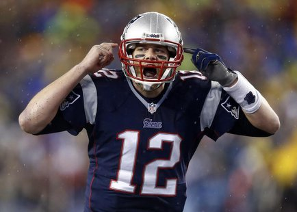 Jan 11, 2014; Foxborough, MA, USA; New England Patriots quarterback Tom Brady (12) gestures at the line in the second half during the 2013 A