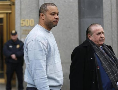 New York State Assemblyman Eric Stevenson (L) and his attorney leave the Manhattan Federal Court in New York April 4, 2013. REUTERS/Brendan