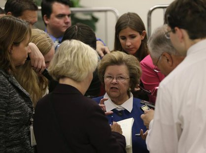 Senator Barbara Mikulski (C) talks to reporters at the U.S. Capitol in Washington September 24, 2013. REUTERS/Gary Cameron