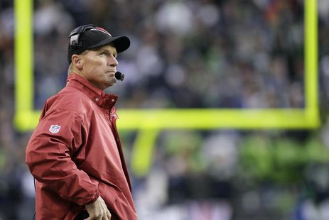 Arizona Cardinals head coach Ken Whisenhunt looks at the game clock during the fourth quarter of their NFL football game against the Seattle