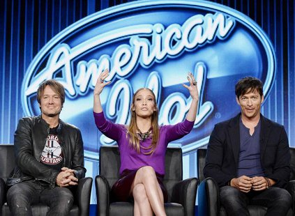 "Judges Keith Urban (L), Jennifer Lopez (C), and Harry Connick, Jr. of ""American Idol"" take part in Fox Broadcasting Company's part of the Te"