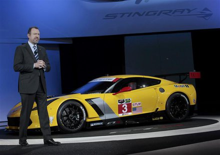 Daniel Ammann, President of GM, speaks next to the Chevrolet Corvette Stingray C7R racing version during the press preview day of the North