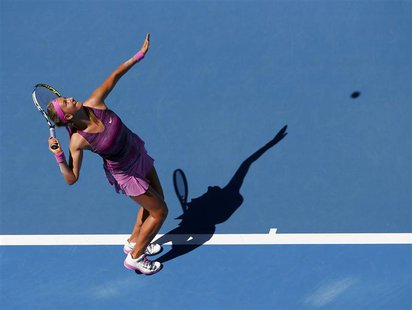 Victoria Azarenka of Belarus serves to Johanna Larsson of Sweden during their women's singles match at the Australian Open 2014 tennis tourn