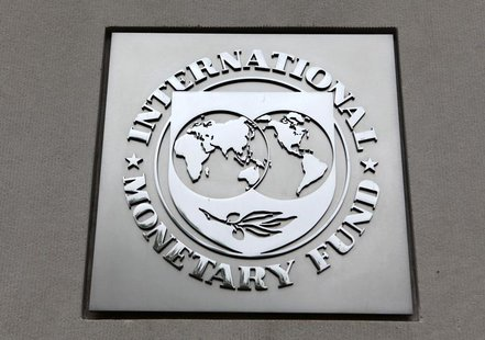 The International Monetary Fund (IMF) logo is seen at the IMF headquarters building during the 2013 Spring Meeting of the International Mone