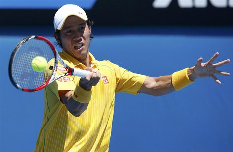 Kei Nishikori of Japan hits a return to Marinko Matosevic of Australia during their men's singles at the Australian Open 2014 tennis tournam