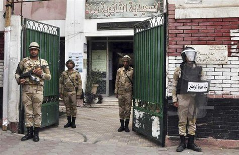 Egyptian soldiers stand guard in the courtyard of a school that will be used as a polling station in downtown Cairo January 13, 2014. REUTER