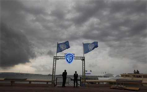Security guards stand at the entrance of the Warner Bros beach during the annual MIPCOM television programme market in Cannes, southeastern