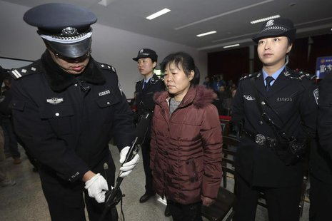 Zhang Shuxia, an obstetrician involved in baby trafficking, stands trial in Weinan Intermediate People's Court in Weinan, Shaanxi province,
