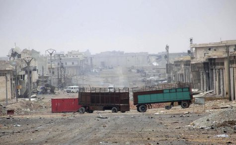 Damaged buildings and vehicles are pictured along a deserted street in the Aleppo town of Naqaren, after forces loyal to Syria's President B