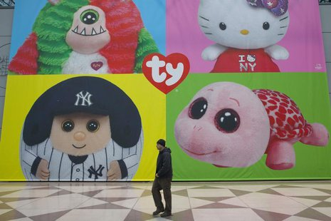 A man walks past a display for Ty Beanie Babies products at Toy Fair 2013 in New York, February 11, 2013. REUTERS/Andrew Kelly/Insider Image