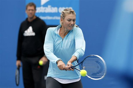 Maria Sharapova of Russia hits a return during a practice session at the Australian Open 2014 tennis tournament in Melbourne January 12, 201