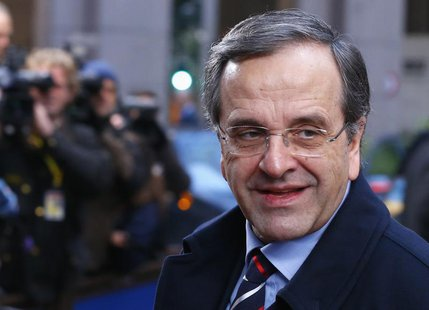 Greece's Prime Minister Antonis Samaras arrives at a European Union leaders summit at the EU council headquarters in Brussels December 20, 2