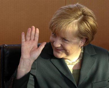 German Chancellor Angela Merkel waves as she leads the first cabinet meeting of the year, at the Chancellery in Berlin, January 8, 2014. REU