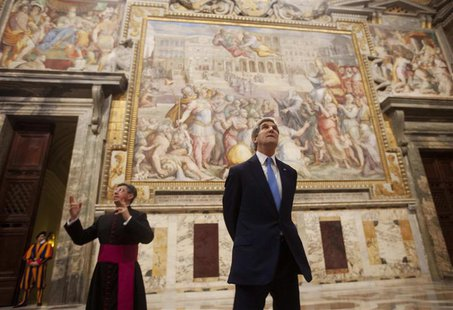 U.S. Secretary of State John Kerry (C) looks up towards an artwork during a tour of a section of the Vatican with Chief of Protocol Monsigno