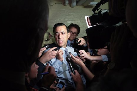 U.S. Representative Darrell Issa (R-CA) talks to reporters as he departs a House Republican caucus meeting at the U.S. Capitol in Washington