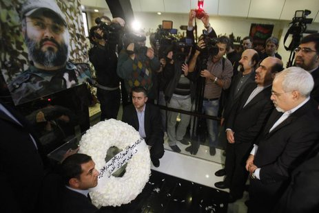 Iran's Foreign Minister Mohammad Javad Zarif (R) and Iran's Ambassador to Lebanon Ghazanfar Roknabadi (2nd R) pay their respect at the grave