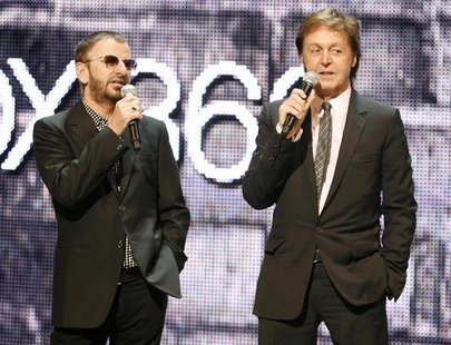 "Ringo Starr (L) and Paul McCartney, of The Beatles, introduce the new video game ""The Beatles: Rock Band"" at the Microsoft XBox 360 E3 2009"