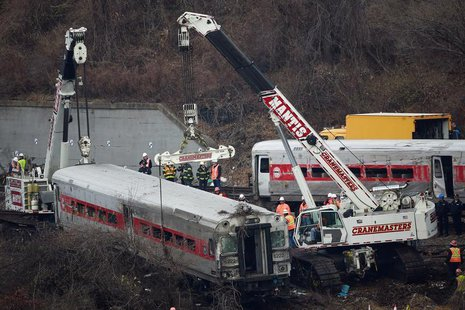 The lead car in the Metro-North train derailment is pulled from the marsh in the Bronx borough of New York December 2, 2013. REUTERS/Shannon