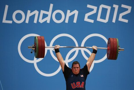 Sarah Robles of the U.S. competes in the women's +75kg group A clean and jerk weightlifting competition at the ExCel venue during the London