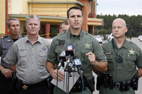 Pasco County Sheriff Chris Nocco (C) speaks to the media as police tape surrounds the Cobb Grove 16 movie theater in Wesley Chapel, Florida, January 13, 2014.  CREDIT: REUTERS/MIKE CARLSON