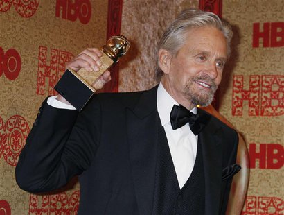 "Actor Michael Douglas holds the Golden Globe Award he won as Best Actor, Miniseries or Movie, for his role in HBO's ""Behind the Candelabra"""