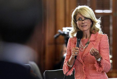 Texas State Democratic Senator Wendy Davis questions the state's Republican Senator Glenn Hegar, sponsor of Senate Bill 1 (SB1), as the stat