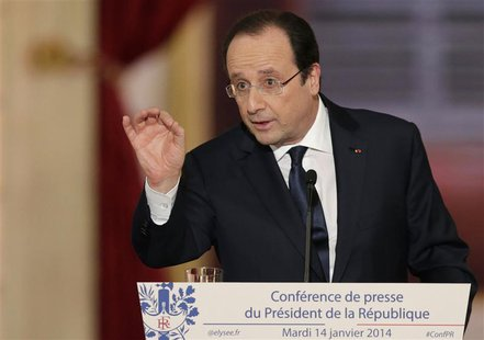 French President Francois Hollande answers a question during a news conference at the Elysee Palace in Paris, January 14, 2014. REUTERS/Phil