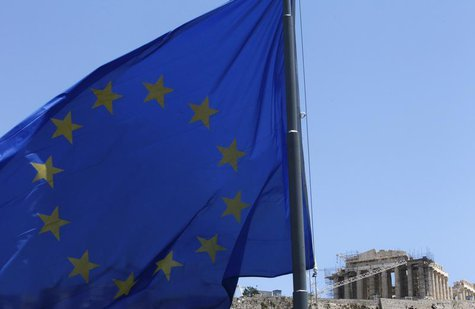 A European Union (E.U.) flag flutters in front of the monument of Parthenon on Acropolis hill in Athens June 17, 2012. REUTERS/John Kolesidi
