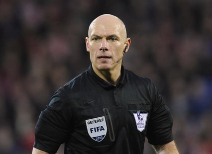 Referee Howard Webb looks on during the English Premier League soccer match between Cardiff City and West Bromwich Albion at Cardiff City St