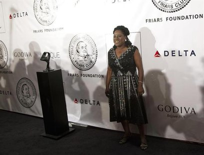 Singer Sharon Jones poses as she arrives before The Friars Club and Friars Foundation honored Tom Cruise with the Entertainment Icon Award a