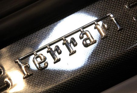 A Ferrari logo is pictured on the footboard of the newly launched F12 Berlinetta car during the second media day of the 82nd Geneva Auto Sho