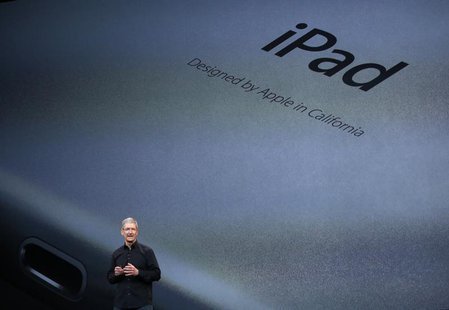 Apple Inc CEO Tim Cook speaks about the new iPad Air during an Apple event in San Francisco, California October 22, 2013. REUTERS/Robert Gal