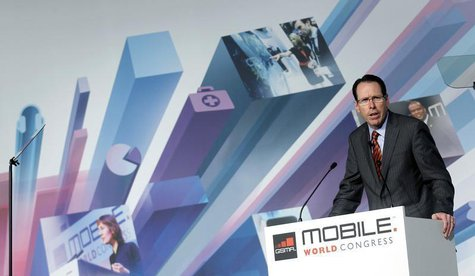 AT&T's Chairman and CEO Randall Stephenson speaks during a news conference at the Mobile World Congress in Barcelona, February 25, 2013. REU