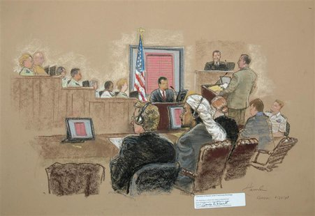 In this photograph of a sketch by courtroom artist Janet Hamlin, reviewed by the U.S. Military, defendant Salim Hamdan (front, 2nd L) looks