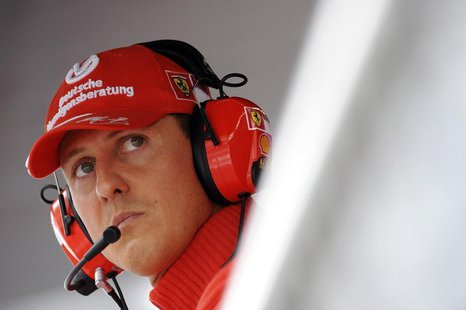 Former Ferrari driver Michael Schumacher of Germany looks on during the qualifying session for the Italian F1 Grand Prix race at the Monza r