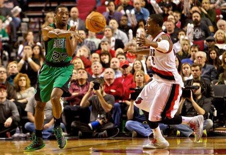 Boston Celtics shooting guard Jordan Crawford (27) passes away from Portland Trail Blazers shooting guard Wesley Matthews (2) at the Moda Ce