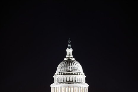 The U.S. Capitol dome is pictured in the pre-dawn darkness in this general view taken in Washington, October 18, 2013. REUTERS/Jonathan Erns