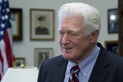 U.S. Representative Jim Moran (D-VA) talks to a television reporter during interviews in his office on Capitol Hill in Washington, January 1