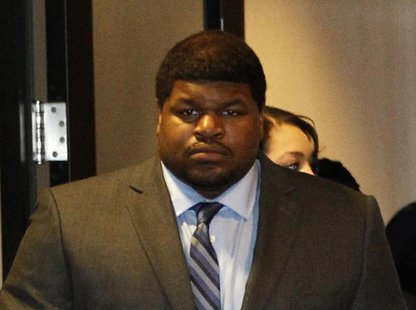 Former Dallas Cowboys player Josh Brent enters the courtroom in Dallas, Texas January 14, 2014. REUTERS/Mike Stone