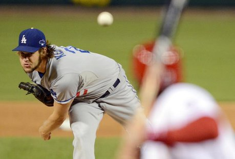 Oct 18, 2013; St. Louis, MO, USA; Los Angeles Dodgers starting pitcher Clayton Kershaw throws a pitch against the St. Louis Cardinals during