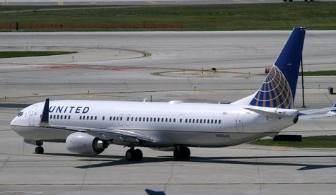 A United Airlines plane with the Continental Airlines logo on its tail, taxis to the runway at O'Hare International airport in Chicago Octob