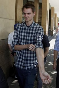 Daniel Dobson, a 22-year-old Briton arrested during an Australian Open tennis match at Melbourne Park on Tuesday, leaves Melbourne Magistrat