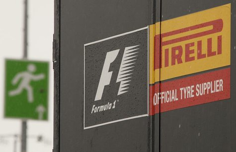An emergency exit sign is pictured next to a truck of Italian official Formula One tyre supplier Pirelli in the paddock area of the Nuerburg