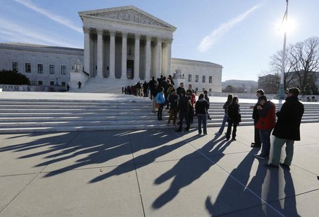 Members of the public cast shadows as they line up in front of the U.S. Supreme Court in Washington January 13, 2014. REUTERS/Larry Downing