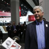 Michigan Governor Rick Snyder (R-MI) is interviewed as he tours the display floor during the press preview day of the North American Interna