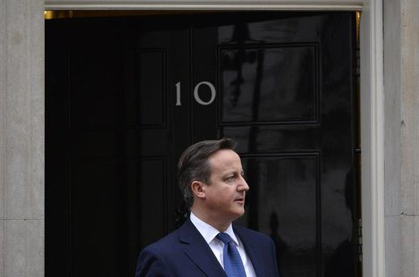 Britain's Prime Minister David Cameron waits to greet Cyprus's President Nicos Anastasiades at Cameron's official residence in Downing Stree