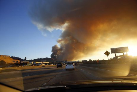 Smoke rises from the Colby Fire seen from the Foothill Freeway approaching Glendora, California January 16, 2014. The fire began early Thurs